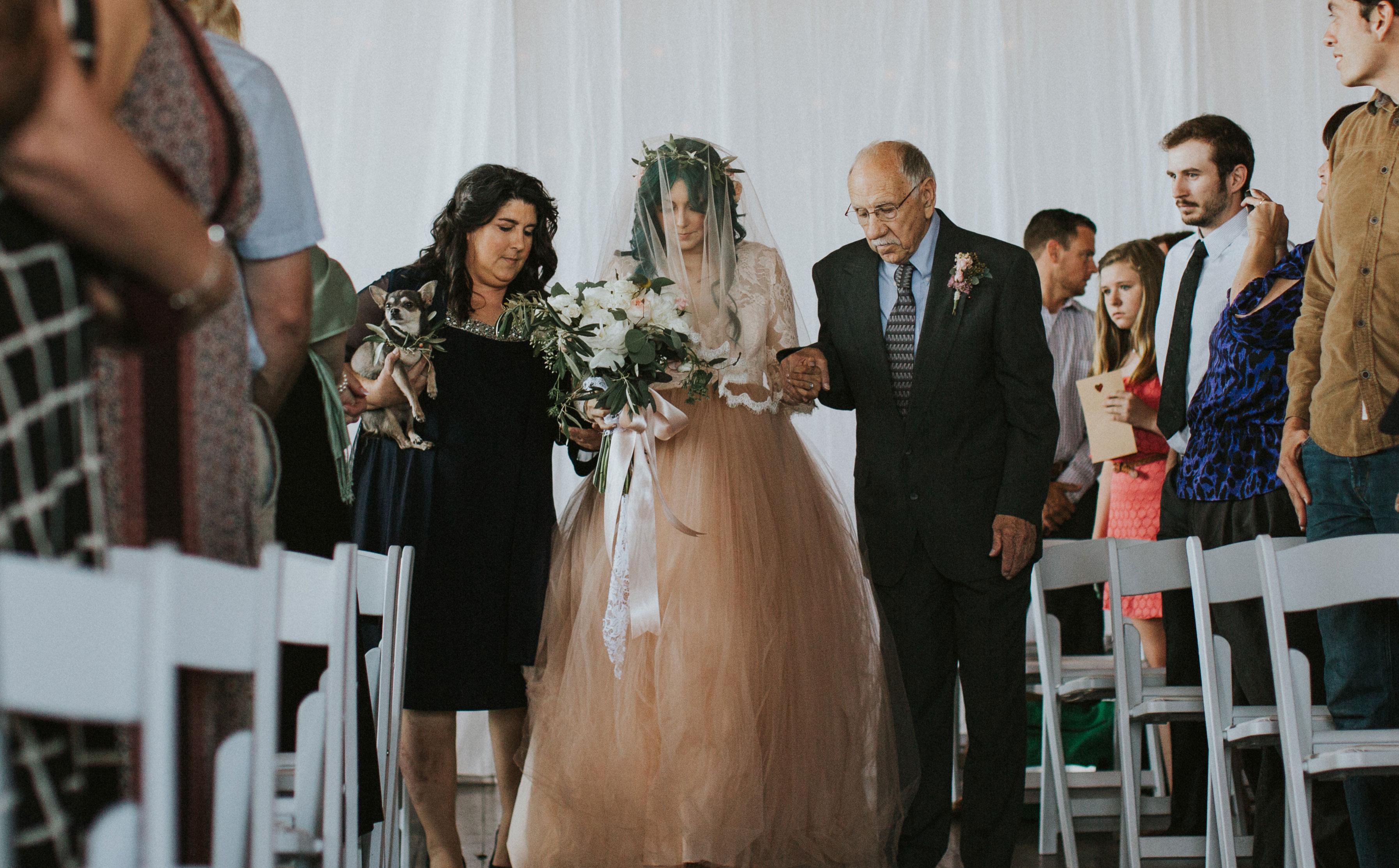 paralyzed bride walks down aisle with parents