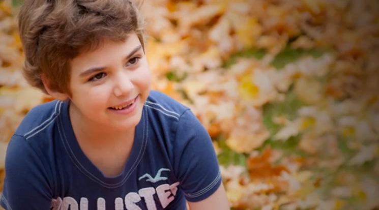 Little girl smiling in park lives cancer free