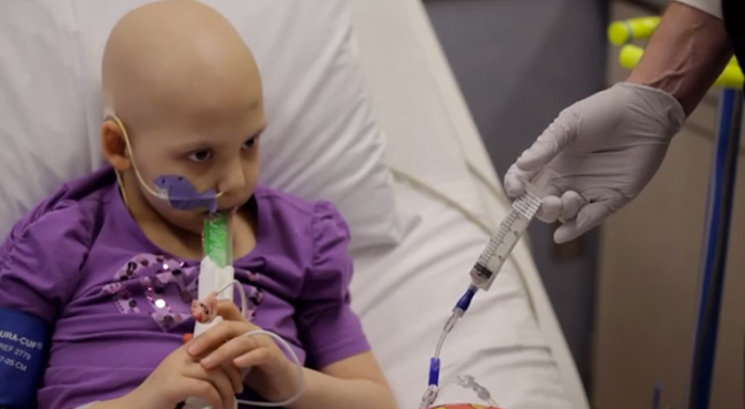 Little girl in hospital sick with cancer