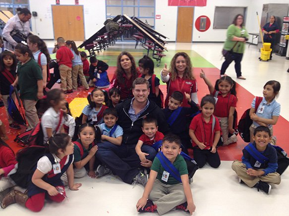 Beaux Wellborn with happy kids with new backpacks