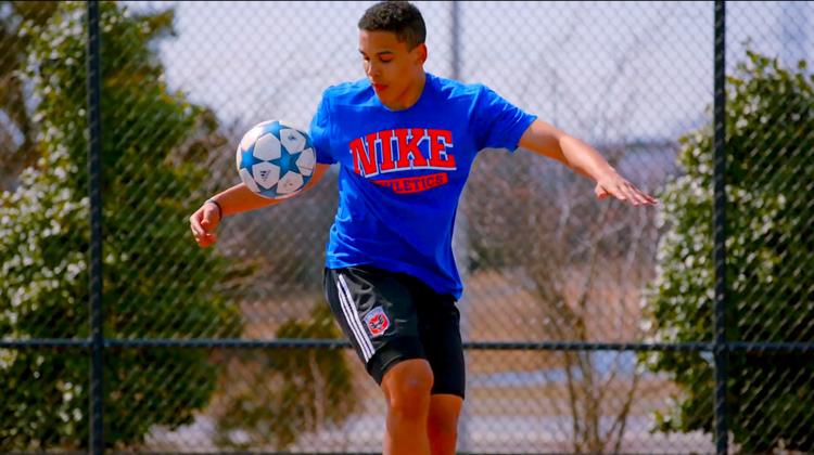 Kid Juggling Soccer Ball
