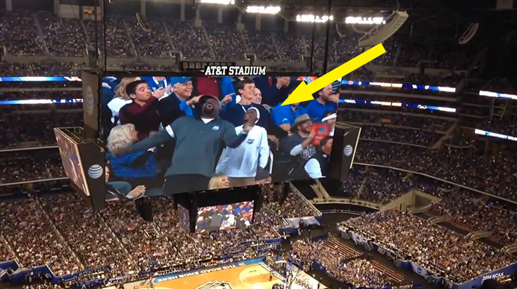 Father son dacning on jumbotron final four