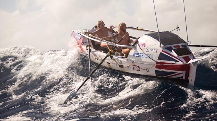 Guys Rowing In High Seas