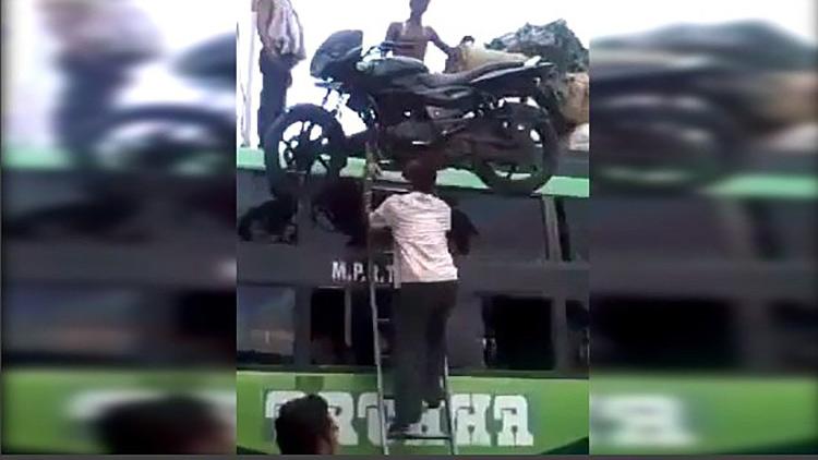 man balancing motorcycle on head