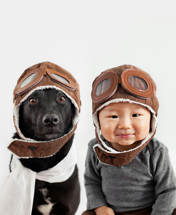 baby and dog dressed as aviators