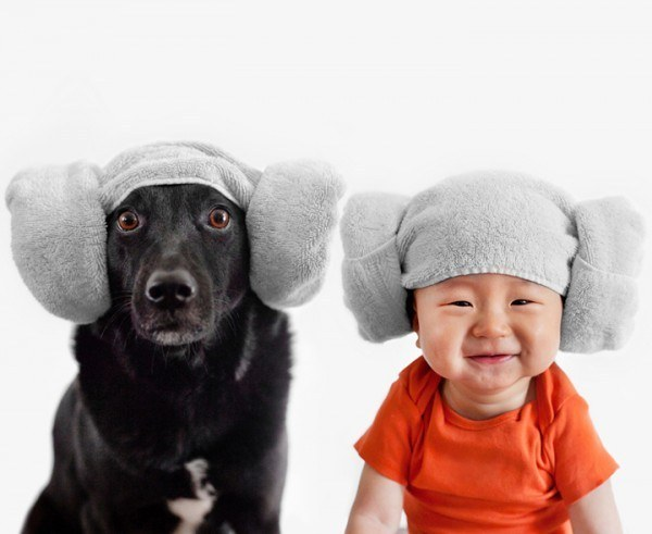 dog and baby wearing towel hats