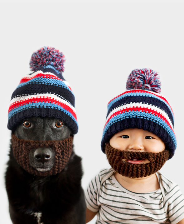 baby and dog wearing beanies with fake beards attached