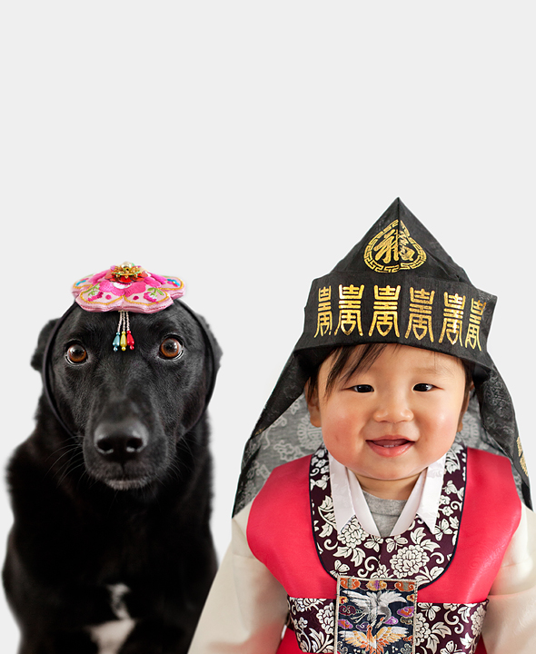 dog and cowboy dressed in a traditional eastern asia fashion