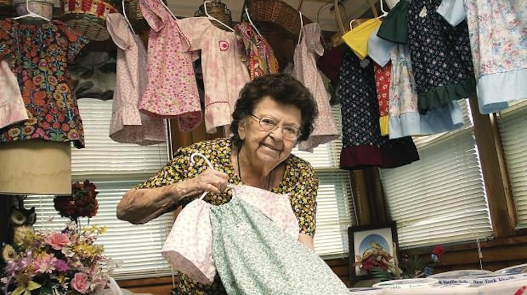 Lillian Weber, 99 year sows dresses for African girls