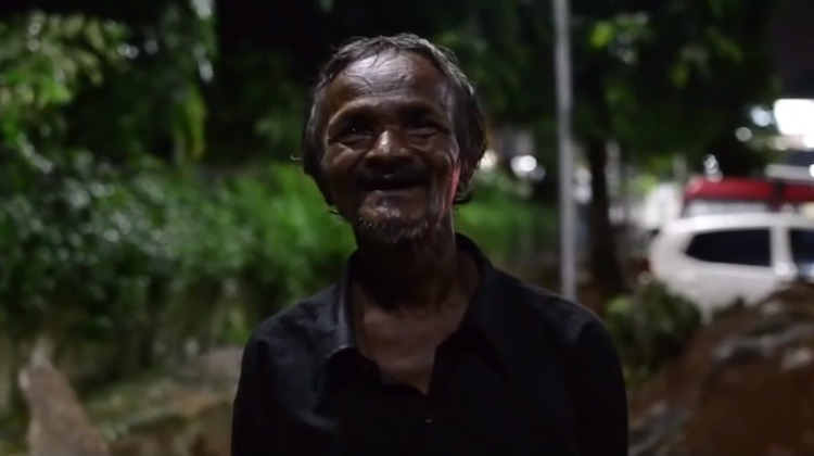 Indian homeless man scours trains for food to feed stray dogs even if he doesn't get a meal himself