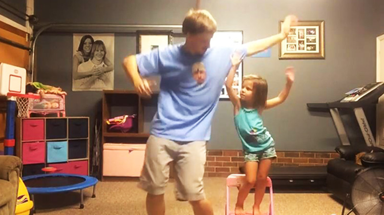 father and daughter dancing to taylor swift song