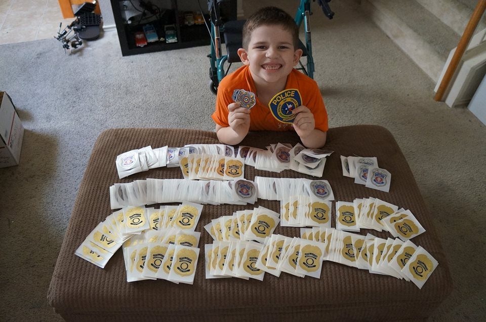kobin and the donated stickers from police department
