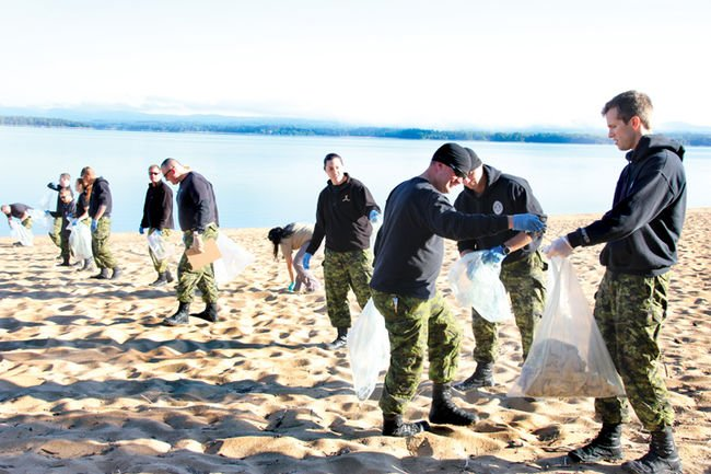 soldiers cleaning up beach