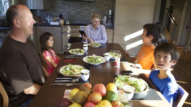 family using transcense at dinner table