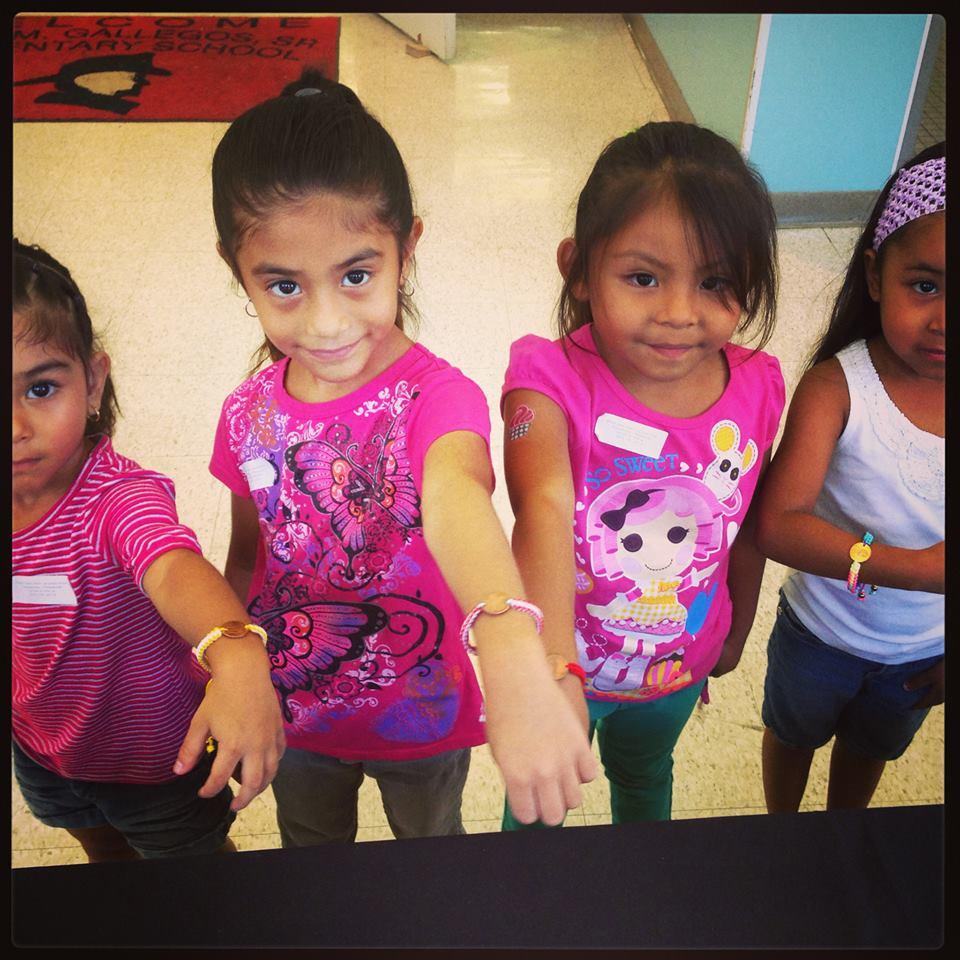 kids wearing pledge cents bracelets