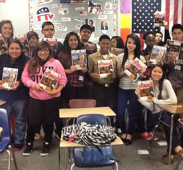 kids with magazines funded by pledgecents campaign