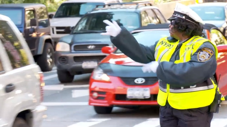 nypd's dancing traffic officer directing traffic