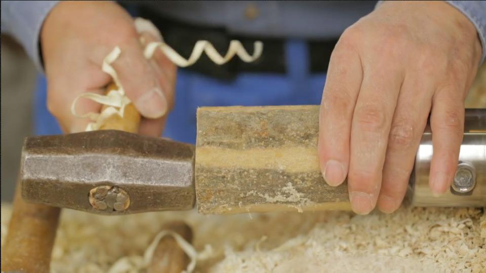 Mr. Okazaki securing wood block to the lathe