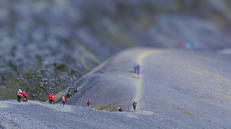 tilt shift photography makes people look like ants on a mountain