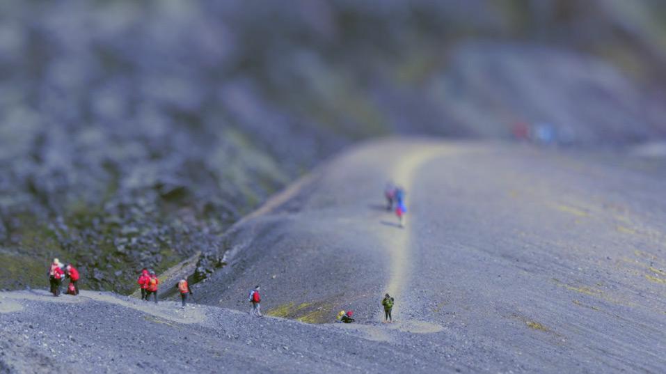 Tilt shift photography of people looking like ants on mountain