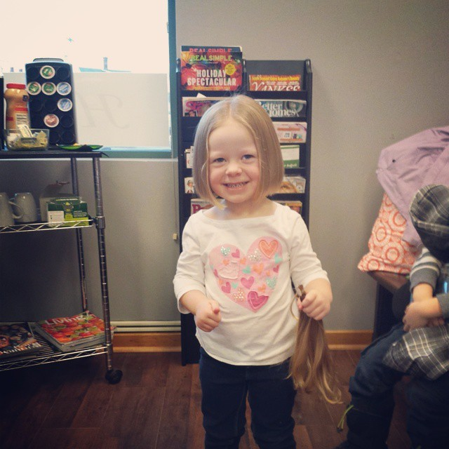 little girl gets haircut