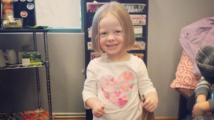 little girl holding hair