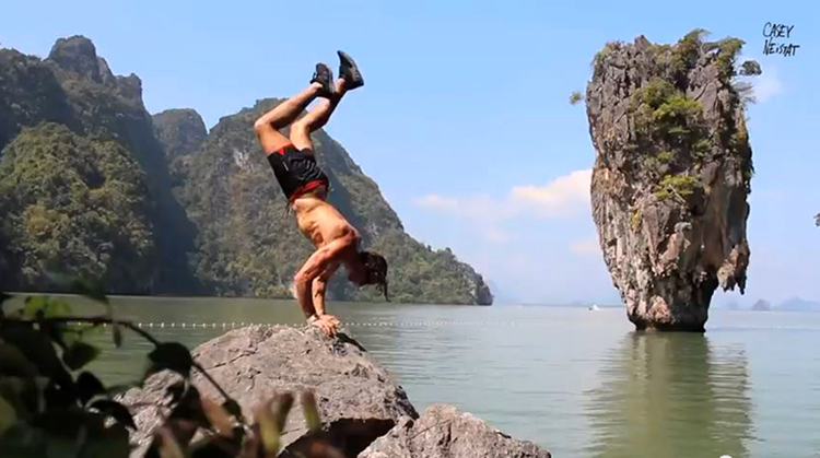 man does crazy handstand in asia