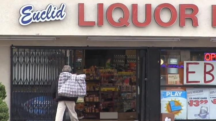 homeless man outside liquor store