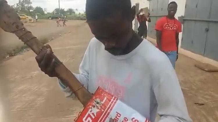 liberian street musician with makeshift guitar