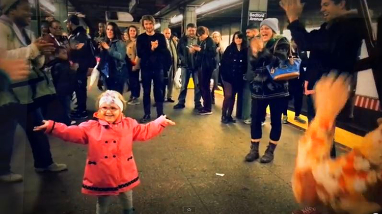 girl dancing in middle of nyc subway