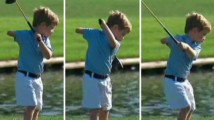swinging the golf club