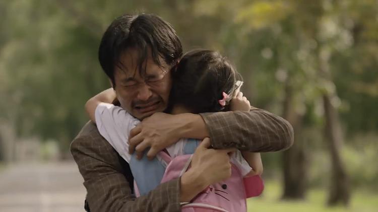 Dad embracing daughter in tears