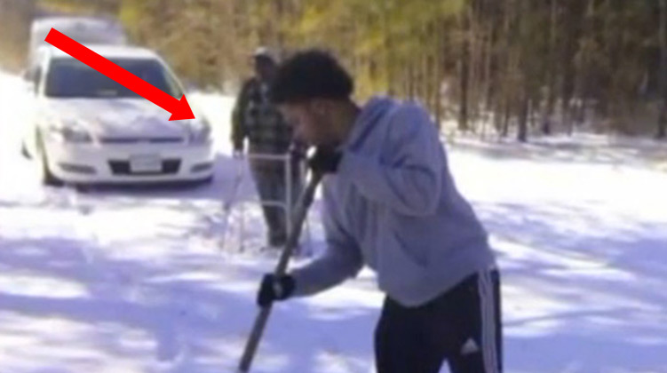 Tommy Adams shoveling snow for elderly man