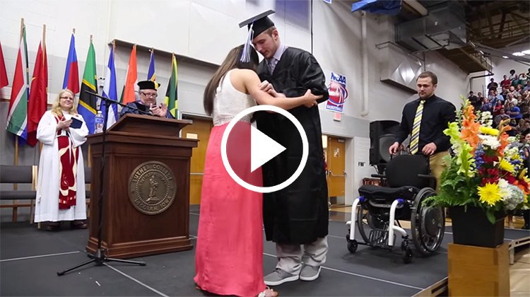 Chris Norton walking across stage with fiance