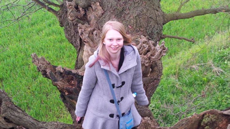 Laura Humphreys by a tree