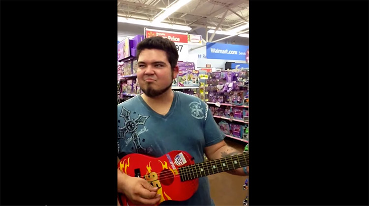 Clay Shelburn playing on toy guitar