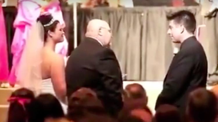 Dad handing over daughter at wedding
