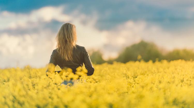 Girl in field of yellow flowers