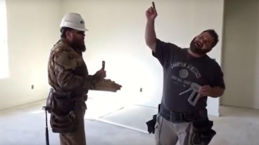 two contractors singing in empty room