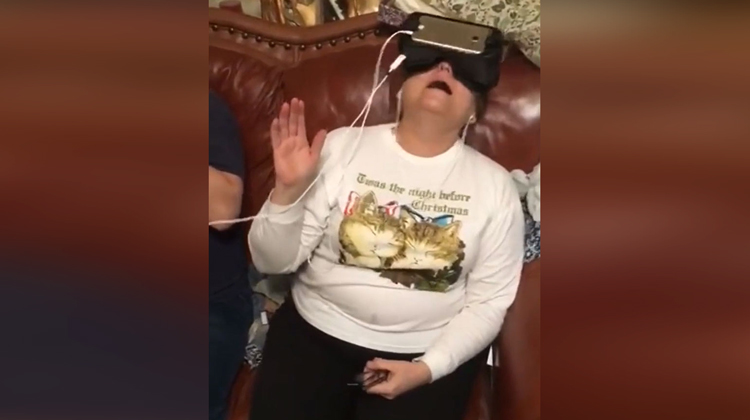 mom with vr goggles and christmas sweater