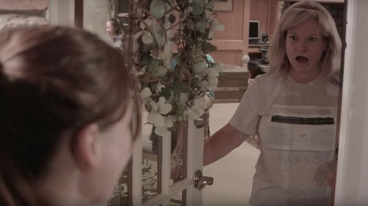 woman shocked at girl at front door