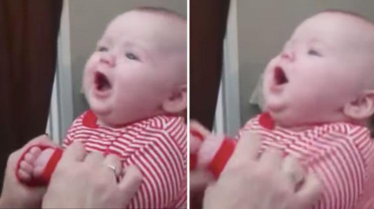 baby in red onesie singing