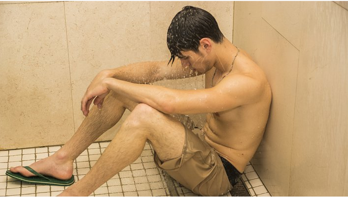 Man crying in shower