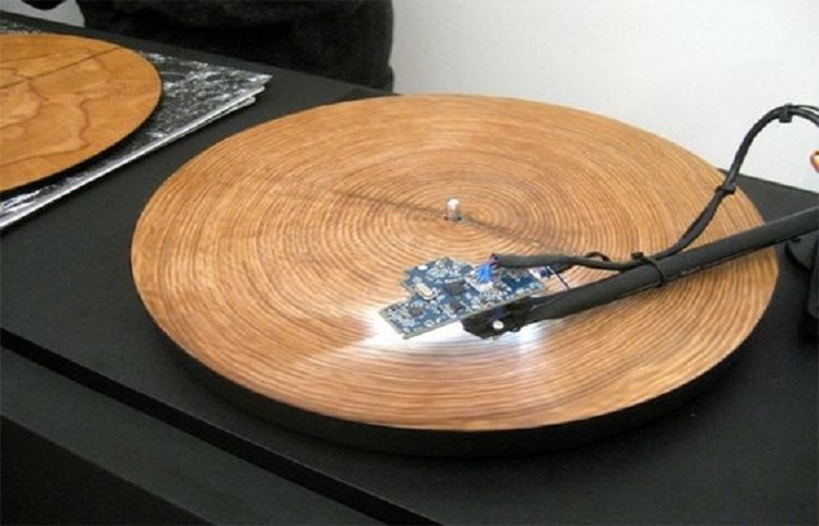 An Austrian artist has designed equipment that translates the year marks in slices of wood into music.