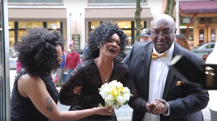 woman in tears when she sees her surprise wedding. wearing black lace dress
