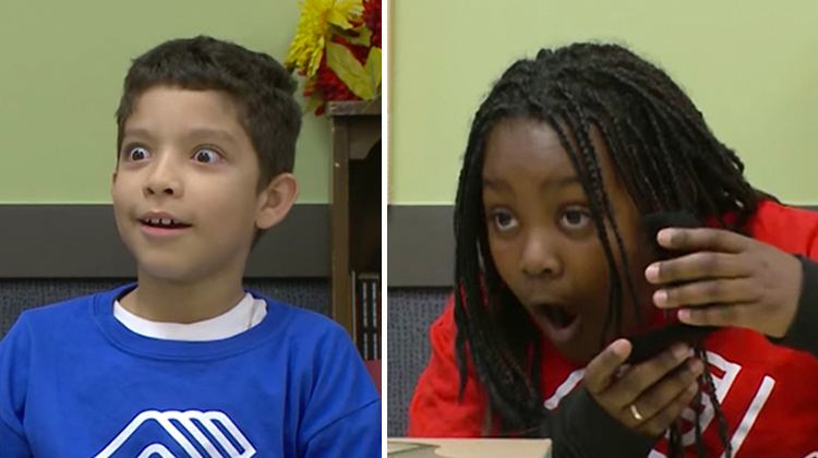 boy and girl with shocked open mouth faces