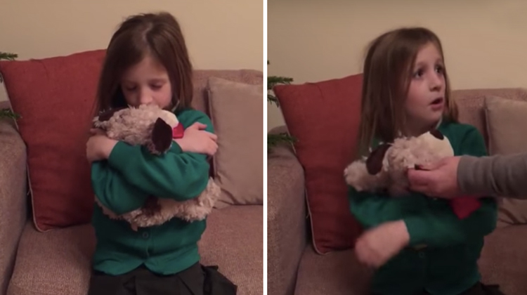 girl holding stuffed animal and stunned as mom grabs it