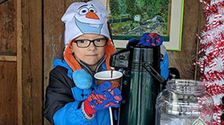 little boy in frozen hat
