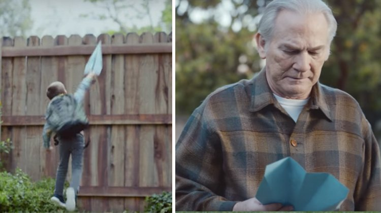 boy throwing blue airplane over fence, old man reading blue note