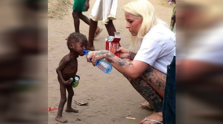 starving baby and blonde nurse giving him water